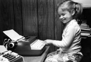 Five year old me typing next to an adding machine didn't know she would become an engineer and fiction writer.