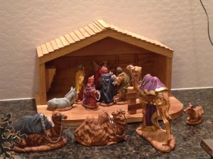 Our keepsake Nativity scene. I like how my 5-year-old Minion placed the figures tight around Baby Jesus.